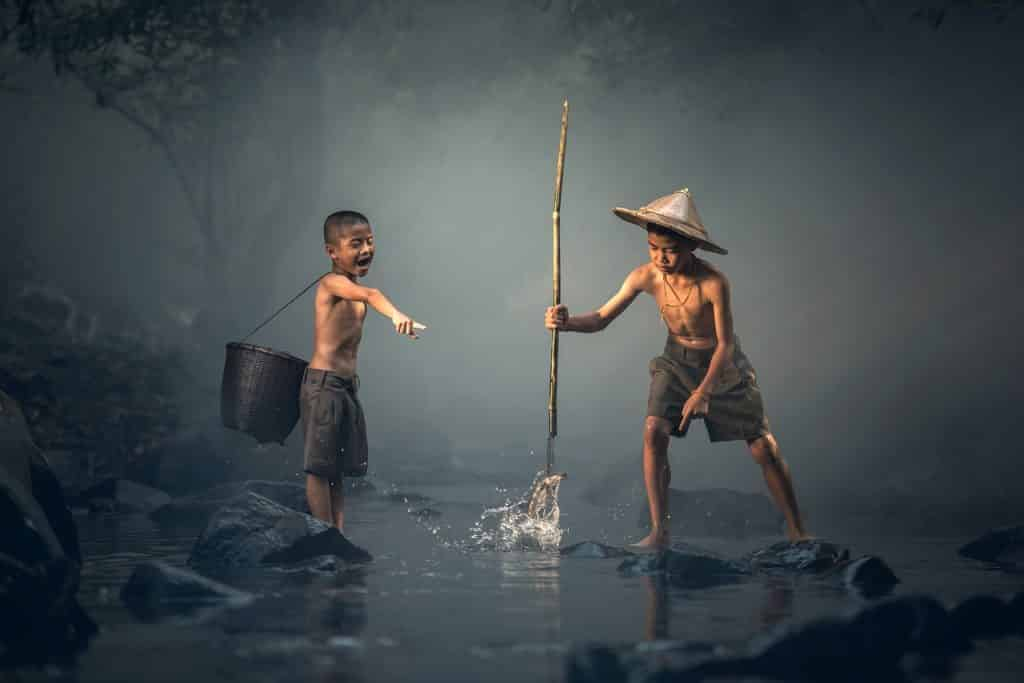 An image of two boys fishing