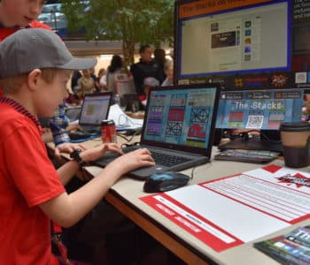 An image of a child playing The Stacks at our stand at Coolest Projects UK