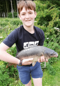 A large carp Morgan caught at Risby fishing ponds.