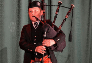 Morgan playing the bagpipes at a Beverley Grammar School concert.